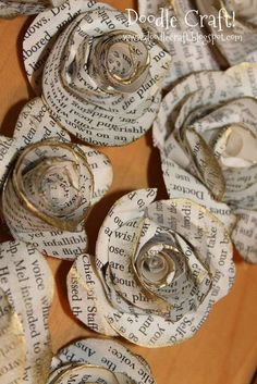 Antique Book Page Handmade Large Spiral Paper Flowers. These large spiral paper flowers are made from vintage book pages and finished off a bit of gold glitters.