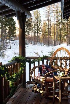 Montana mountainside log home porch in wintertime
