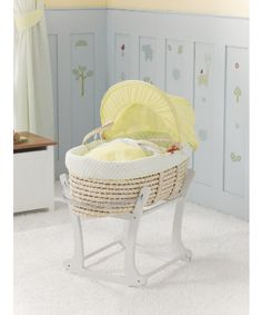 A Colourful Moses Basket Featuring The Snoozie Safari Characters To Create A  Cosy Place For Your New Baby To Sleep.