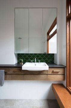 tiny green tile backsplash in the bathroom