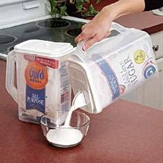 I saw these at Walmart! There is a pour spout and at spoon out lid. I will be getting a couple for several things! Flour, sugar, cornmeal, cornstarch, baking powder... Limitless possibilities!