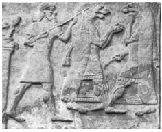 Detail from Nimrud BM 124548 with lyte player.