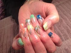 Coloured tips with painted detail, nail art