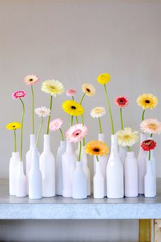 colorful gerbera daisies in milk glass vases Fresh Flowers, Beautiful Flowers, Happy Flowers, Decoration Evenementielle, Deco Floral, Wedding Decorations, Table Decorations, Bottle Crafts, Floral Arrangements