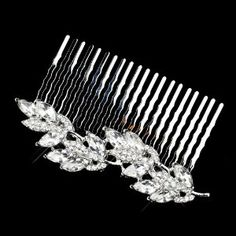"Katia Dazzling Rhinestone Leaf Wedding Bridal Comb by Fairytale Bridal Tiara. $39.99. Size: 3.25"" (Length) 1"" (Width). Crystal Embellishment. Leaf Design. Marquise Cut Rhinestones. An elegant antique silver comb in marquise cut rhinestones and encrusted clear crystals embellishment in a leaf design that is plated with antique silver. This piece is soft and elegant perfect for your modern, or classic wedding look.  Size: 3.25"" (Length) 1"" (Width)"