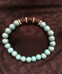 A personal favorite from my Etsy shop https://www.etsy.com/ca/listing/577954129/turquoise-howlite-lava-rock-essential