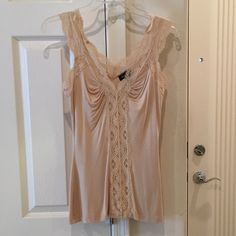 BEBE LACE TANK TOP Cream color great for under a jacket. Stretchy material. Some very light stippling. bebe Tops Tank Tops