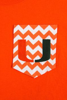 Short sleeved T-shirt with Chevron pocket and University of Miami Embroidery. Perfect for the Miami Hurricane's fans!