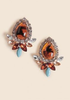 Unusual and beautiful amber earrings with the hint of turquoise