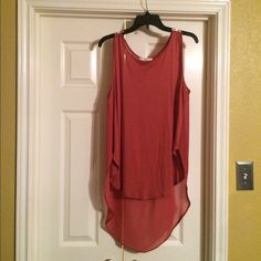 Lush high low tunic tank Here's a high low tunic tank size large by Lush.  The front is a soft cotton and the back a silky see through material.  The color is a orange.   I cut the tags out because they were visible through the blouse but I have never worn this cute top.   It needs a new home! Lush Tops Tunics