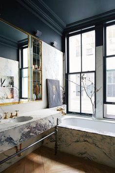There are so many aspects of this bathroom I love I don't know where to start. I love the black paint on the wall, ceiling and trim. The marble on the sink and tub really brightens up the space. All of these selections paired with warm natural hardwoods and gold accents really create an awesome look! #Inspiration #bath #marble #blackandwhite #GreenBasementsandRemodeling #AtlantaConstruction