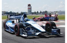 Alex Tagliani led the IZOD IndyCar Series 2012 Edmonton Indy but came in 5th at the end at the Edmonton Indy at the city centre airport in Edmonton, July 22, 2012.