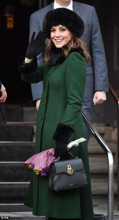 Pregnant Kate's baby bump was barely visible beneath the stylish green coat by favourite r...