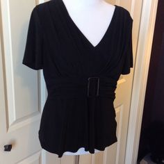 Black Top with Faux Belt Cute v neck top with gathered front and faux belt. 95 polyester 5 spandex. Sized as a 14P Danny & Nicole Tops