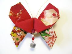 This gorgeous fabric origami butterfly ornament was handmade with beautiful oriental print on red fabric.    In Asian culture, the butterfly has long symbolized a new beginning.