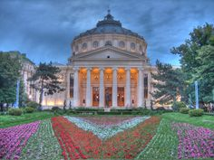 The Romanian Athenaeum (Ateneul Român) is a concert hall in the center of Bucharest, Romania and a landmark of the Romanian capital city. Bucharest Romania, Concert Hall, Capital City, Homeland, Wander, Taj Mahal, Cool Pictures, Places To Visit, Europe