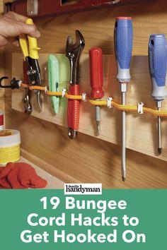 19 Bungee Cord Hacks to Get Hooked On – Garage Organization DIY Tool Shed Organizing, Workbench Organization, Garage Organization Tips, Garage Tool Storage, Garage Tools, Workbench Plans, Shed Storage, Garage Workbench, Workbench Stool