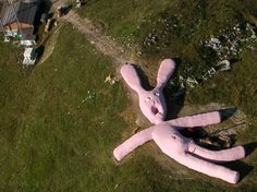 A 200-foot-long toy rabbit lies on the side of the 5,000 foot high Colletto Fava mountain in northern Italy. It was knitted as an outdoor sculpture for people to climb on, sleep on, and play with. It's expected to remain there until 2025. See it on Google Maps: http://maps.google.com/maps?t=k=ABQIAAAA7naSvBBMzKYAZM-XglsY-hR_wUS_wskmkuIfDW_7PQ1uIWLTjRRIMbPsskky1ZeCFFOWDWhtVVQCHw=UTF8=44.244208,7.769732=0.003389,0.006271=18=1