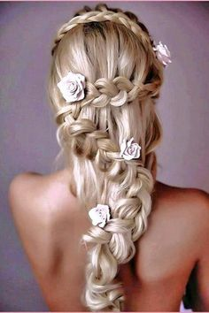 An angelic zig-zag braided hairdo with mini floral hair adornments. {Featured by: I Just Said Yes}