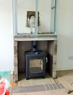 installing a wood burning stove in a false chimney breast. Below lintel, masonry construction and single-wall flue pipe; above lintel, twinwall insulated flue pipe and frame for board. Gas Wood Burner, Log Burner Fireplace, Fireplace Frame, Home Fireplace, Fireplace Design, Fireplace Ideas, Fireplaces, Log Burning Stoves, Wood Burning