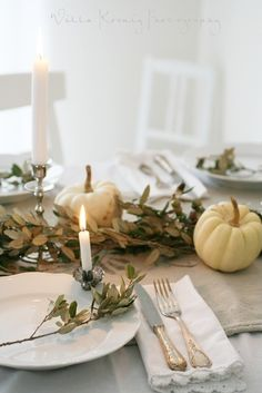 FALL*SPIRATION - Whiite Ironstone, Crochet Linens, Ivory Utensils, Lit Candles, with Dried Leaves and White Pumpkins.  A Classic and Quaint Tablescape!