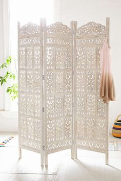 Urban Outfitters Amber Carved Wood Room Divider Screen Intricately carved wooden screen in a tri-fold silhouette. This sturdy standout piece works perfectly as a room divider. Only at Urban Outfitters. Room Divider Diy, Room Divider Screen, Divider Ideas, Room Divider Headboard, Divider Design, Shabby Chic Room Divider, Headboard Ideas, Design Room, House Design