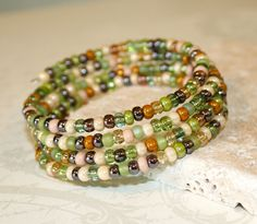 Autumn Sage bracelet, Sage green Czech Glass Memory Wire Bracelet, Fall accessory, Beaded Cuff. $20.00, via Etsy.