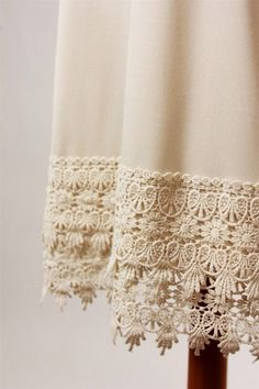 Crochet Lace slip/dress extender. Perfect for adding a little extra length to dresses and tunics! High quality lace trim and stretchy slip portion.