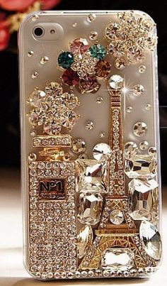 ln102 - Iphone 5 handcrafted luxurious bedazzled case featuring 3D crystal perfume bottle and Eiffel Tower. $39.99, via Etsy.