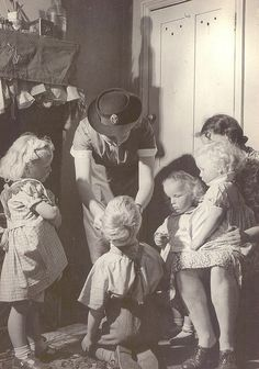 A traveling nurse stops in to visit a patient in this sweet slice-of-life image from 1949. #forties #nurse #vintage #1940s #children #mother #uniform