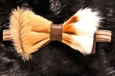 Bow tie made of Brown leather and Caramel Impala, with Cream highlights. The bow tie is adjustable and has Brown satin lining. This item also has a matching hat sold separately. Please allow 3-4 weeks for delivery. NOTE: ONLY 1 LEFT OF THIS ITEM, SO IF INTERESTED, ACT FAST!  INTERNATIONAL SHIPPING COSTS VARIES DEPENDING UPON LOCATION. Please inquire within.