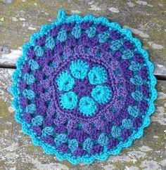 African Flower Mandala Pot Holder - make your kitchen a work of art! #crochet