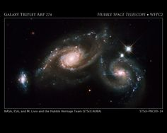 Galaxy Triplet Arp Arp 274 is a trio of galaxies. They appear to be partially overlapping in this image, but may be located at different distances. ~ Credit: NASA, ESA, M. Livio and the Hubble Heritage Team (STScI/AURA) Hubble Space Telescope, Space And Astronomy, Telescope Images, Nasa Space, Cosmos, Other Galaxies, Spiral Galaxy, Hubble Images, Star Formation