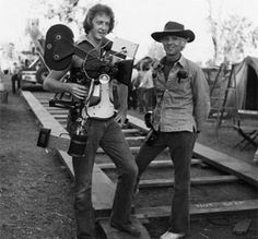 Garrett and Haskell | ShotOnWhat? Behind the Scenes https://onset.shotonwhat.com/gallery/garrett-and-haskell/ This photo was taken on the set of the film Bound for Glory (1976). Cinematographers Garrett Brown (left) and Haskell Wexler (right) are posing for this picture. Bound for Glory was the first motion picture in which inventor/operator Garrett Brown used his new Steadicam for filming moving scenes. Here you can see that Garrett is holding his new Steadicam. Garrett wo