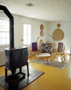 wood stove over yellow floors
