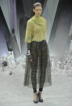 lovin the sheer skirt over the leggings with a pop of colour on top...Paris Fashion Week: Chanel autumn/winter 2012