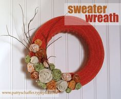 sweater wreath with rolled fabric and burlap flowers designed by Patty Schaffer