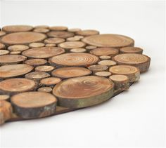 This gorgeous piece can be used for your centerpiece on a table, a trivet, or as a piece of art hung on a wall. It would be a beautiful conversation piece however you used it. Made out of reclaimed NW woods, I hand pick a variety of tree branches (type and diameter), cut them to a depth of 1/4, and create this unique piece. Dimension choices upon ordering are approximately: 15 diameter and 5/8 thick 18 diameter and 5/8 thick 20 diameter and 5/8 thick *If you desire a diff...