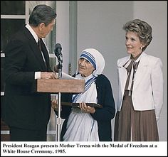 Mother Teresa receiving the Medal of Freedom at a White House ceremony in 1985 by President Reagan.