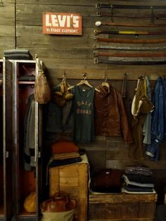 Vintage Levi's sign is so sweet, along with the rustic belts. Midwest-dirt