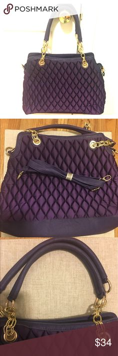 Purple Quilted Bag Quilted bag is in a vibrant purple. Gold tone hardware and extra long strap provided. Bag also has several zippered pockets. New without tags. Some loose ends at mouth of the bag (pictured). Bags Shoulder Bags
