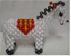 Resultado de imagen para الكريات السحرية 2014 Beaded Clutch, Beaded Animals, Ornament Wreath, Wreaths, Beads, Mini, Decor, Gallery, Image
