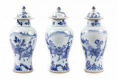 """Set 3 Chinese Blue & White Covered Vases,  Realized Price: $1,300 Estim: $1,000 - $2,000 Chinese, circa 1720. Matched set  of 3 Chinese K'ang Hsi (1663-1723) blue & white slender baluster vases w/ covers, ea. painted with mounted lady & attendant in mountainous river landscape. Approx. height 11""""."""