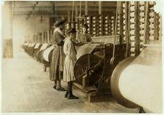 1908 - Girls running warping machines in Loray mill, Gastonia, N.C.