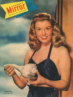 Doris Day - what the hell is she holding?