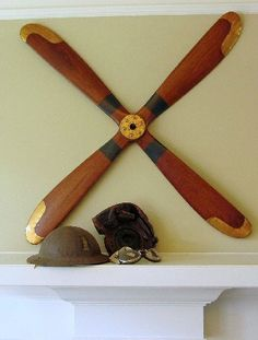 pretty awesome propeller for an airplane room. what had four blades? Airplane Bedroom, Airplane Decor, Train Nursery, Car Nursery, Men Apartment, Apartment Therapy, Aviation Theme, Inside Man, E Room