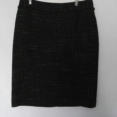 """NWT Ann Taylor tweed pencil skirt Gorgeous Ann Taylor pencil skirt. Black tweed with flecks of cream. Back zipper. Closed back slit at bottom. Fully lined. 58% wool, 32% acrylic, 10% nylon. Size 8. NWT retail price $109.?  Measurements laying flat:? Length: 22.5""""? Waist: 15"""" Ann Taylor Skirts Pencil"""