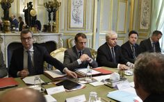 Macron seeks extension of French state of emergency By AFP French president Emmanuel Macron (2L) flanked by Secretary General o...
