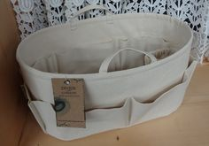 Diaper Bag ORGANIZER insert / Handles / Stiff, Wipe-Clean Vinyl Bottom / 2 Loops / 15 x 7 x 7H / You choose color / Fits Neverfull GM. $72.95, via Etsy.