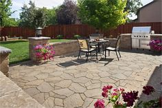 Paver patio with sitting wall and built-in grill